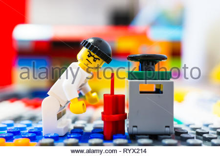 Poznan, Poland - March 14, 2019: Lego escaped prisoner tries to blow up a safe with dynamite. - Stock Image