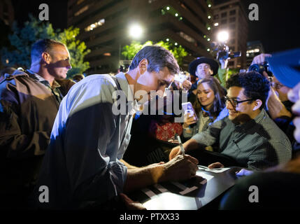 Former Texas congressman Beto O'Rourke of El Paso signs an autograph for excited supporter after kicking off his 2020 presidential campaign at a late-night rally in front of the Texas Capitol in Austin. - Stock Image