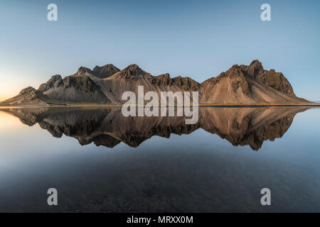 Stokksnes, Hofn, Eastern Iceland, Iceland. Vestrahorn mountain mirrors in the waters of the Stokksnes bay. - Stock Image