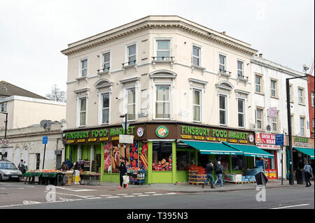 Finsbury Food Market store with people passing in Finsbury Park London Borough of Islington England Britain UK - Stock Image