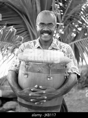 A Bele drummer hugs his drum in happiness. Fort de France, Martinique. Caribbean. - Stock Image
