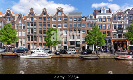 Traditional Dutch houses at Prinsengracht canal in Amsterdam, Netherlands - Stock Image