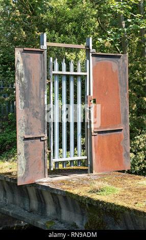 Gate Across Bridge, Coppermill Stream, Walthamstow Wetlands, London Borough of Waltham Forest, England Britain UK - Stock Image