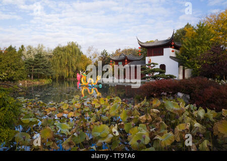 The Stone Boat pavilion and Lotus pond with the Magic of Lanterns exhibit in the Chinese Garden, Montreal Botanical Garden, Quebec, Canada - Stock Image