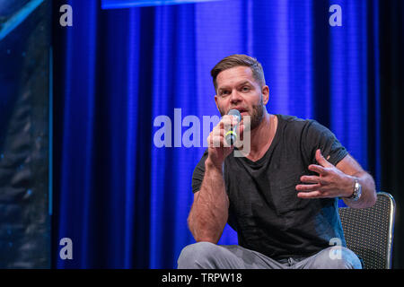 Bonn, Germany - June 8 2019: Wes Chatham (*1978, actor - The Expanse) talks about his experiences in The Expanse at FedCon 28, a four day sci-fi convention. FedCon 28 took place Jun 7-10 2019. - Stock Image