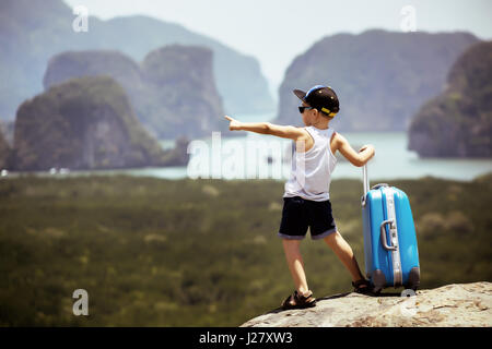 Child with baggage case travel concept - Stock Image