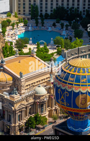 The Paris Las Vegas Hotel taken from a high viewpoint, on The Strip, Las Vegas, USA, showing the swimming pool - Stock Image