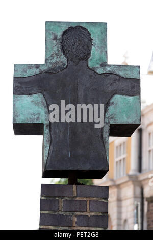 Sculpture of Christ Crucified by Sean Henry outside the Roman Catholic Church of Our Lady Immaculate & St Frederick, Commercial Road, London, UK. - Stock Image