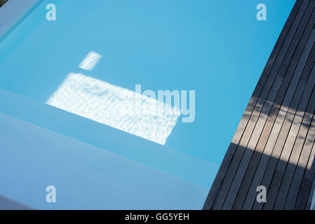 High angle view of swimming pool in resort - Stock Image