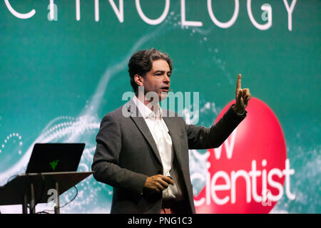 Chemist Lee Cronin explaining how we will soon be able to make computers with chemicals, on the Technology Stage, at New Scientist Live - Stock Image