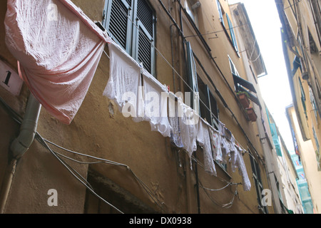 Washing hanging in the back streets of Genoa, Italy. - Stock Image