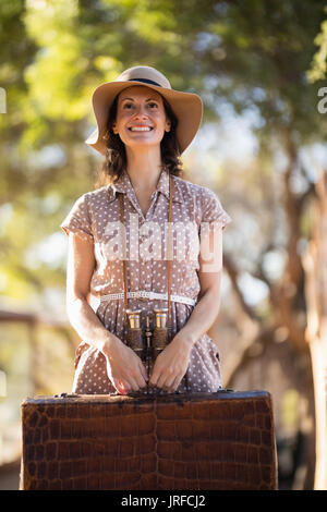 Senior woman holding briefcase - Stock Image