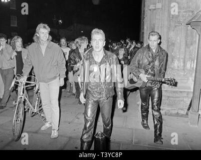 The British Punk Rock Group The Clash at York in England on 8th May 1985. This was part of a simple busking tour of UK cities the band did, at very short notice. Lead singer Joe Strummer and guitarist Paul Simonon are the main subjects. - Stock Image