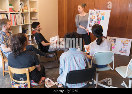 Creative designers meeting, discussing proofs - Stock Image
