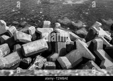 Concrete sea defence blocks at Brighton Marina UK - Stock Image