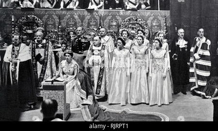coronation of Elizabeth II of the United Kingdom, took place on 2 June 1953 at Westminster Abbey, London. Queen Elizabeth II, with the Duke of Edinburgh, at Buckingham Palace shortly after their return from Westminster Abbey - Stock Image