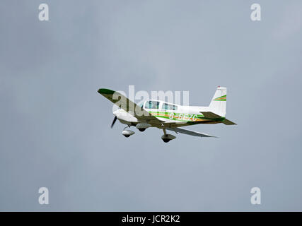 A Grumman four seat single engine monoplane departing Inverness airport in the Scottish Highlands. - Stock Image