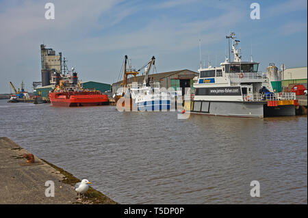 Boats moored at the quayside on Lake Lothing in Lowestoft, Suffolk,England. - Stock Image
