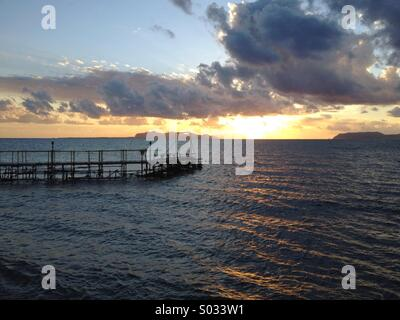 Sea subset with pier and islands view - Stock Image