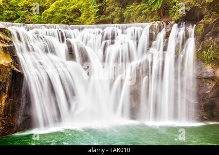 Majestic Shifen Waterfall in Pingxi District of New Taipei City, Taiwan, on the upper reaches of the Keelung River. The famous cascading waterfall is  - Stock Image