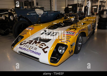 Three-quarter front view of a Yellow and White, 1971, Lola T212, in the International Pit Garages, at the 2019 Silverstone Classic Media Day - Stock Image