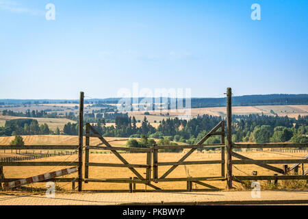 Wooden gate at a ranch in a beautiful rural landscape - Stock Image