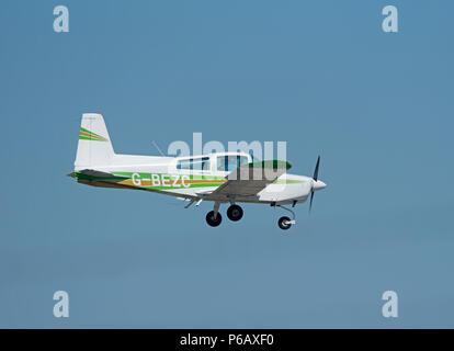A Grumman AA5 -Traveller light 4 seat private aircraft coming in to land at Inverness Dalcross Airport in the Scottish Highlands. - Stock Image