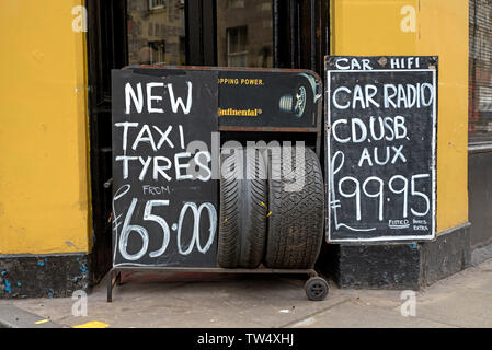 Tyre & Battery Depot, a small family business dealing in car audio, tyres and batteries in Tollcross, edinburgh, Scotland, UK. - Stock Image
