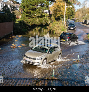 Sidmouth, 29th Oct 18 Cars cross the river Sid at the town centre ford in Sidmouth. on a glorious sunny day on the Devon coast. Photo Central/Alamy Live News - Stock Image