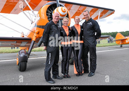 AeroSuperBatics Ltd British aerobatics and wingwalking team. Performing as the Breitling Wingwalkers. Steve Hicks, Charlotte Voce, Guilding, Barrell - Stock Image