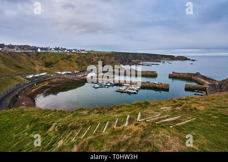 Portknockie is an old herring fishing village located in the Moray Firth on the coast of the North Sea, north of Scotland, UK. - Stock Image