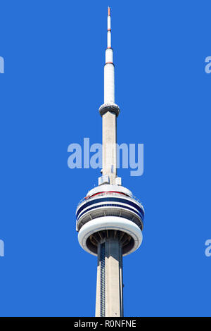 TORONTO, CANADA - AUG 29, 2012: Top of CN Tower showing unidentified visitors walking on the outside ledge of the main pod as part of the popular attr - Stock Image
