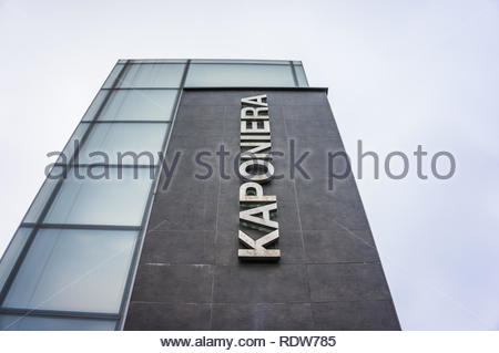 Poznan, Poland - November 21, 2018: Kaponiera passage building with text from low perspective with cloudy sky in the city center. - Stock Image