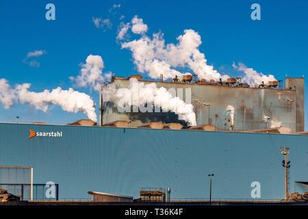 Saarland, Germany - Jan 19 2019: Smokes vapors steams of Deutsch Saarstahl steel factory for long products, steel rolling in Völklingen (Volklingen) t - Stock Image