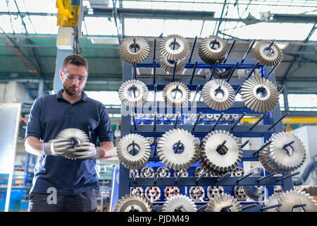 Engineer selecting cutting tool in gearbox factory - Stock Image