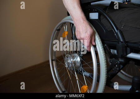 Close up of a senior man in wheelchair - Stock Image
