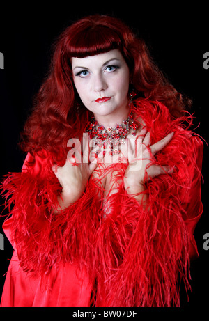 Singer and Burlesque Performer Nichole Klein in a Red Ostrich Feather Dress - Stock Image