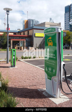 View of an electric car charging station located next to a car park near Bowen Street within Adelaide, South Australia, Australia. - Stock Image