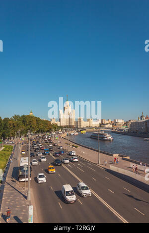 Moscow, Russia - July 31, 2018: Highway in Moscow with traffic and views of the Stalin skyscraper on the horizon - Stock Image