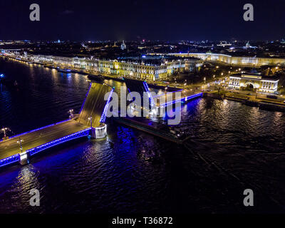 Summer night, Saint Petersburg, Russia. Neva River. A ship passes under drawn bascule moveable Palace bridge. Winter Palace. Admiralty. Palace Square. - Stock Image
