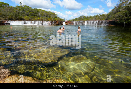Tourists swimming at picturesque Fruit Bat Falls, a population destination in the Cape York Peninsula, Far North Queensland, FNQ, QLD, Australia - Stock Image