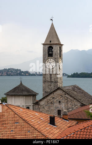 View from roof top terrace of Hotel Rosa Baveno Italy with view of church clock tower and Lago Maggiore - Stock Image