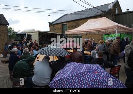 Rain fall at the Mac's Beer & Music Festival 2019. The festival was in the brewery and had live music, and food stalls. - Stock Image