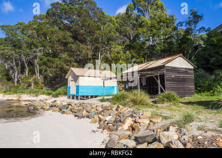 Beach huts, beach by Pambula river estuary, New South Wales, Australia - Stock Image