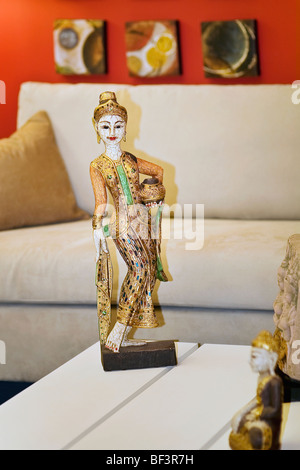 Figurines on a table - Stock Image