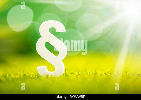 Close-up Of White Paragraph Symbol On Green Grass - Stock Image