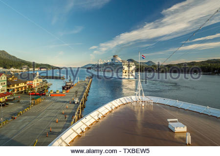 Sept 17, 2018 - Ketchikan, AK: Panorama of Tongass Channel, waterfront and departing cruise ships at sunset, from bow of The Volendam. - Stock Image