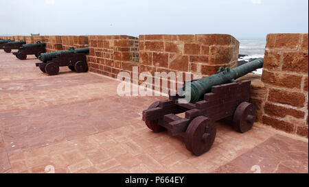 cannons on the city walls at Essaouira, protecting the city from invasion from the sea - Stock Image