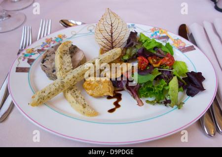 Truffle-stuffed quail with pear chutney - Stock Image