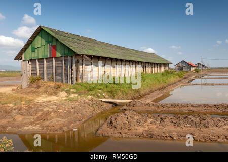 Cambodia, Kampot Province, Kampot, Tuek Chhou, Salt Fields, wooden buildings used to store salt - Stock Image